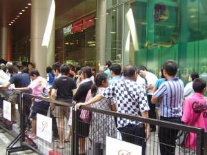 Crowd control measure are taken as Bangkokians line up to purchase Krispy Kreme Doughnuts
