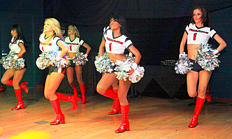 Football Houston Texan cheerleaders. Photo Credit Cpl Lance Marcel Brown via Wikimedia Commons.