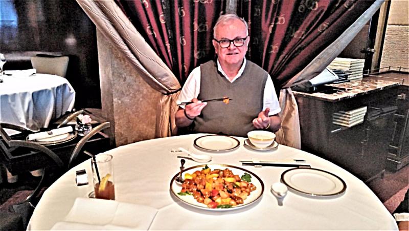 travel-blogger-michael-taylor-eating-sweet-and-sour-pork-copyright-www.accidentaltravelwriter.net