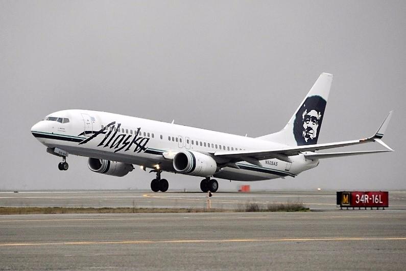 Alaska Airlines jetliner taking off from Seattle International Airport.