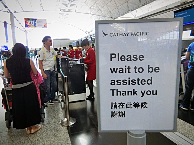 cathay-pacific-airways-check-in-counter-at-hong-kong-bangkok-credit-www.accidentaltravelwriter.net